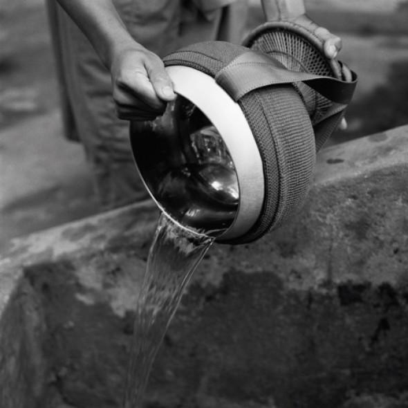 Hans Georg Berger KARMA - THE ALMS BOWL Luang Prabang, Laos, 2004 Silver Gelatine DOP vintage print, 60cm x 60cm